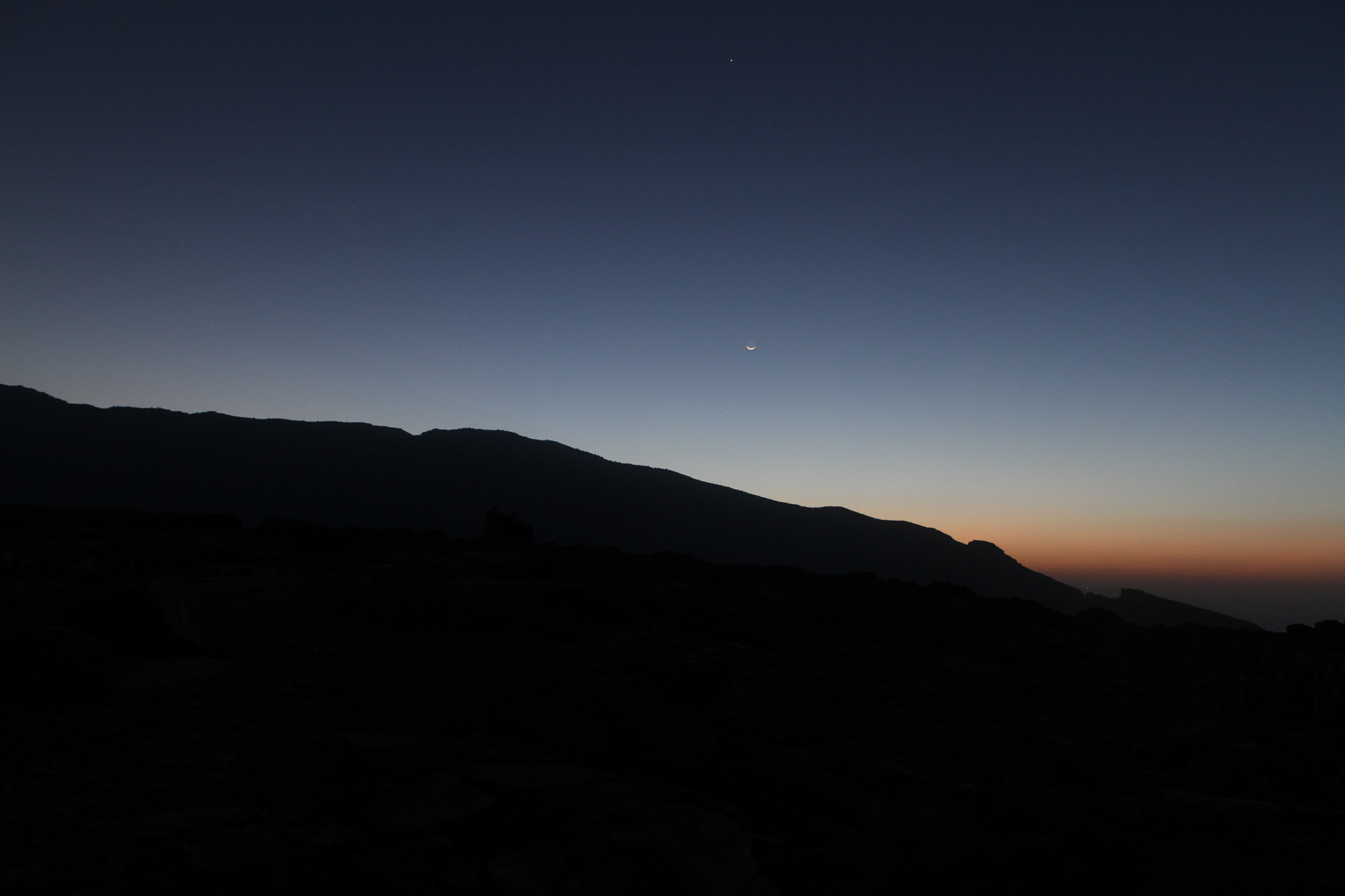 Sunrise of the Hajdar Mountains with a very small moon.