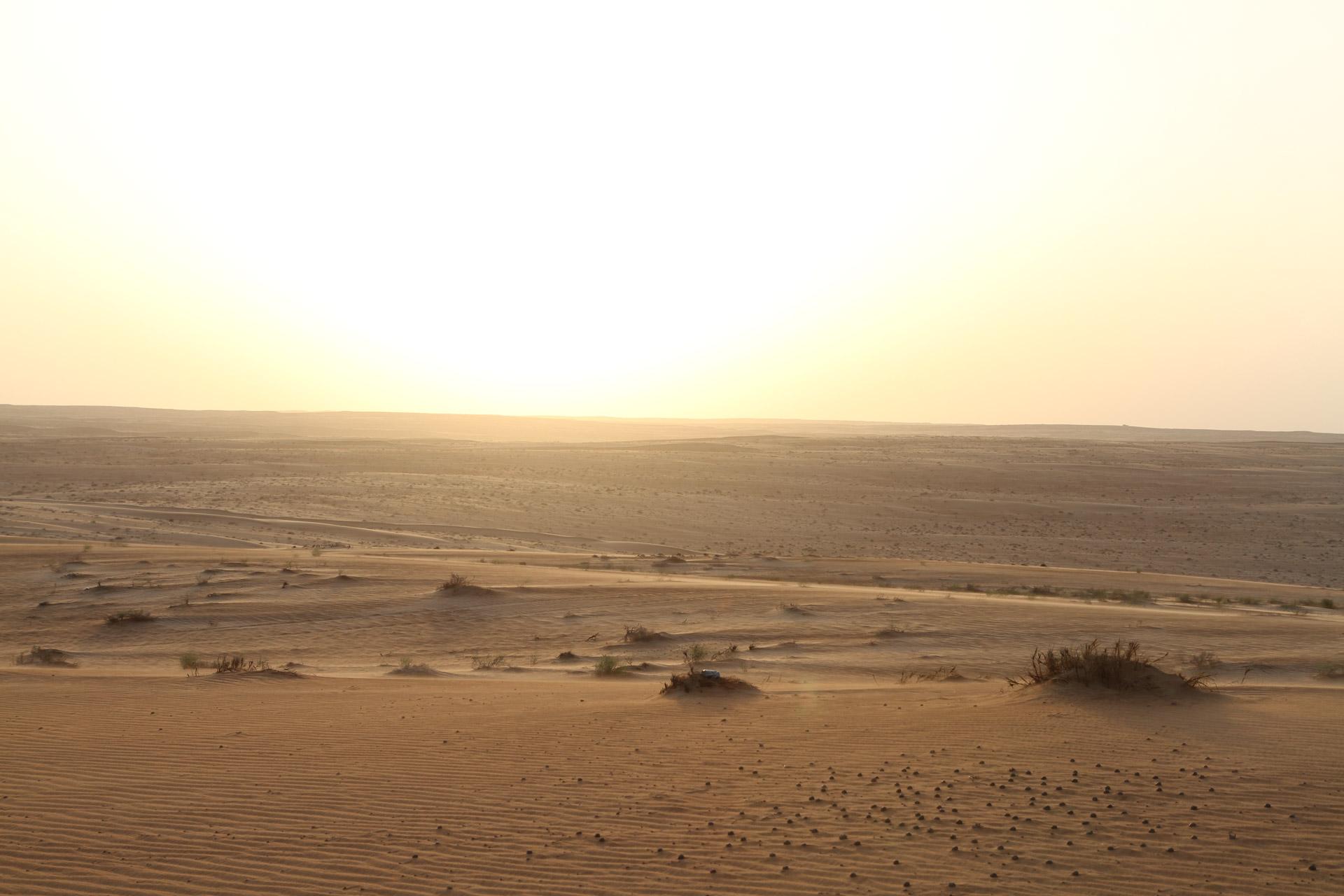 Sunset above the dusty desert.